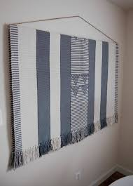 hang a large heavy rug on the wall