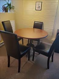 dinning room table and 4 parson chairs