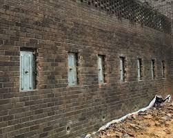 failing retaining wall repair in al tn