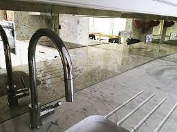 mirror backsplash kitchen