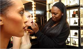 a celebrity makeup artist dusts her