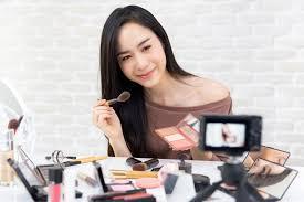 beauty vlogger recording makeup