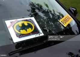 A Car In The Funeral Procession Displays A Batman Decal Along With News Photo Getty Images