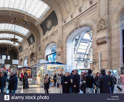 MILAN, ITALY - FEBRUARY 24, 2019: passengers in hall of Stazione ...