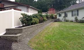 Tiered Retaining Wall With Vinyl Fencing In West Olympia Ajb Landscaping Fence