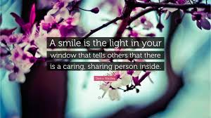 """denis waitley quote """"a smile is the light in your window that"""