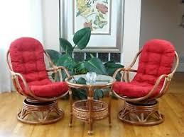 set of 2 bali swivel rocking chairs w