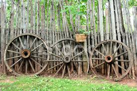 Vintage Wagon Wheels And Rustic Log Fence Stock Photos Freeimages Com