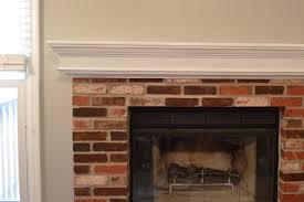 brick fireplace white mantle