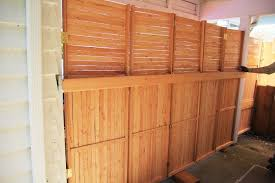 Building An Accordion Fence For The Carport Exterior Carport Building Tall Cabinet Storage