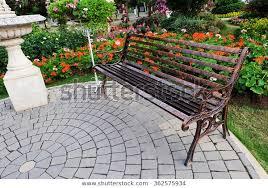 park bench flower garden stock photo