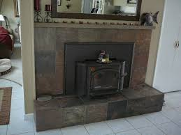 slate tiled over red brick fireplace