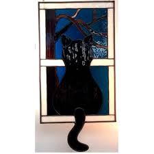 stained glass black cat looking out