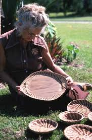 Florida Memory • Iva Campbell showing baskets she made