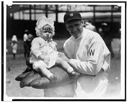 Walter Johnson, half-length portrait, facing slightly left, holding little  girl on large glove] | Library of Congress