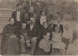 John Wesley & Elizabeth Lyons Hughes family. Seated in Front from Left to  Right Elizabeth Lyons Hughes, Harvey Tilmon Hughes(in lap), John Wesley  Hughes, Saphro…