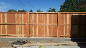 Redwood Fence With Covered Steel Posts On Concrete Footing Landscapes By Rhodes