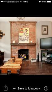 exposed brick fireplace with wooden