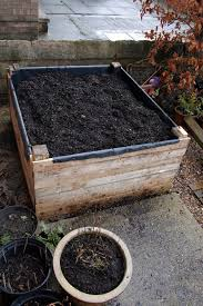 build a raised bed out of pallets 11