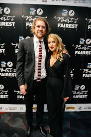 Aaron Young with his partner - Port Adelaide Football Club | Facebook