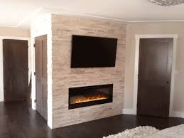 electric fireplace and tv brick wall