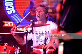 Drummer Adrian Young of the band No Doubt performs onstage during ...