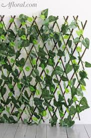 Find Outdoor Decorations Like This Beautiful Plastic Expandable Lattice Fence Covered With Uv Protected Pl Vertical Garden Design Vertical Garden Trellis Fence