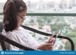School Kid Using Internet Online Learning And Reading E Book On Mobile Tablet App For Educational Studying And Playing Game Stock Photo Image Of Girl Gadget 186011300