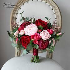 باقة زفاف جميلة من بياوركيد لزهور الزفاف باللون الأحمر العنابي