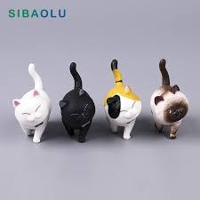 kitten with bell figurine cartoon cat