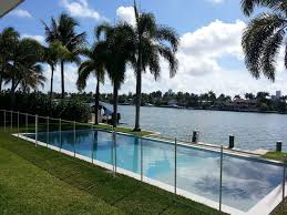 Black Pool Fence With White Border And Poles Installed In Grass Pool Florida Pool Pool Fence