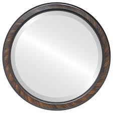framed round mirror in vintage walnut