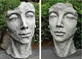 garden statue face man woman or couple