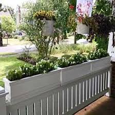 White Flower Boxes Sit On Top Of Porch Railings Railing Planters Porch Flowers Deck Railing Planters