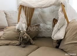 A Pillow Fort Made Of Blankets Chairs With A Stuffed Animal In The Living Room Great For Kids Watching Movies Buy This Stock Photo And Explore Similar Images At Adobe Stock