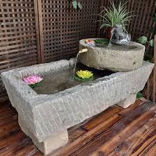 stone fish tank sink flow water