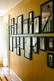 display framed photographs on a wall