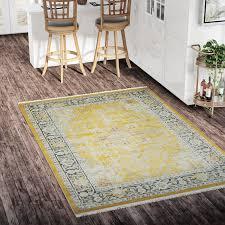 bungalow rose lonerock yellow area rug