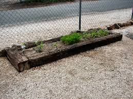 flower beds made out of railroad ties