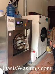 Lắp đặt máy giặt công nghiệp phố Nguyễn Khánh Toàn, Cầu Giấy, Hà Nội