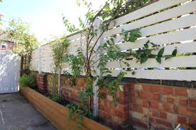 Diy How To Create A Slat Fence With Pallet Wood Kezzabeth Diy Renovation Blog