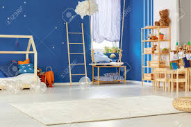 Navy Blue Stylish Kids Room With Simple Swing Stock Photo Picture And Royalty Free Image Image 82490750