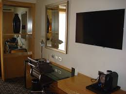 wall mounted flat screen tv and lots of
