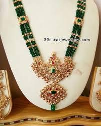 green jades long set with locket gold