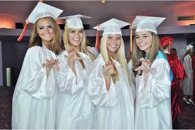 May Year in Pictures: Sarasota - Briana Smith, Layni Chamberlain, Angela  Mich and Claire Whitacre show off their Cougar spirit during Cardinal  Mooney's graduation ceremony at the Van Wezel. | Your Observer