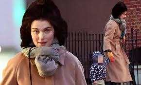 Rachel Weisz wraps up in a camel coat and oversized hat | Daily Mail Online
