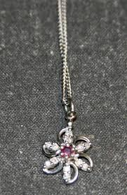 14 kt white gold diamond ruby flower