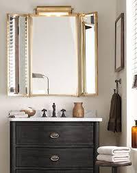 tri fold lit wall mirror in antique