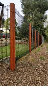 Roll Top Fence With Wooden Posts Backyard Fences Backyard Fence Decor Backyard Dog Area