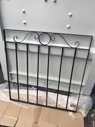black wrought iron metal garden gate